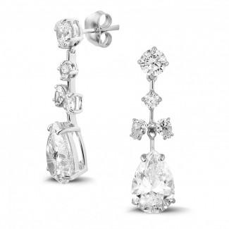 7.00 karaat oorbellen in wit goud met ronde en peervormige diamanten