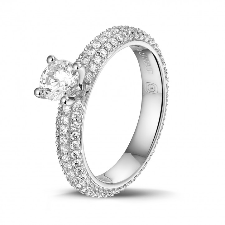 0.50 karaat solitaire ring (volledig rondom gezet) in platina met zijdiamanten