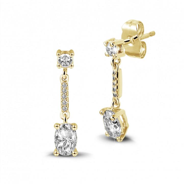 1.04 karaat oorbellen in geel goud met ovale diamanten