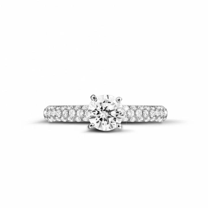 0.90 karaat solitaire ring (half gezet) in platina met zijdiamanten