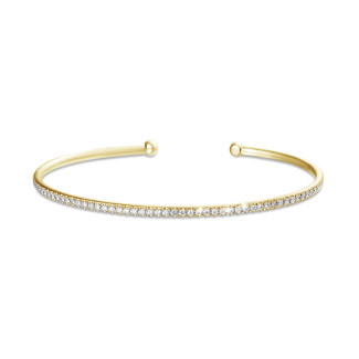 0.75 caraat diamanten slavenarmband in geel goud