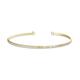 Geelgouden Diamanten Armbanden - 0.75 karaat diamanten slavenarmband in geel goud