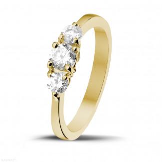 0.67 caraat trilogie ring in geel goud met ronde diamanten