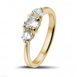 0.95 caraat trilogie ring in geel goud met ronde diamanten