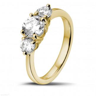1.50 caraat trilogie ring in geel goud met ronde diamanten